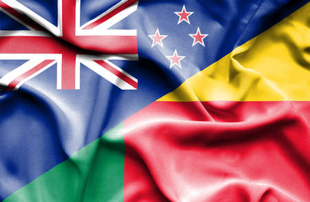 benin: Waving flag of Benin and New Zealand Stock Photo