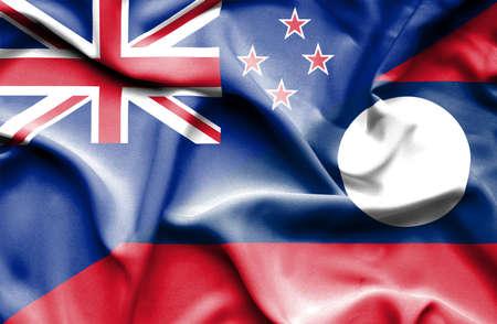bandera de nueva zelanda: Ondeando la bandera de Laos y Nueva Zelanda Foto de archivo