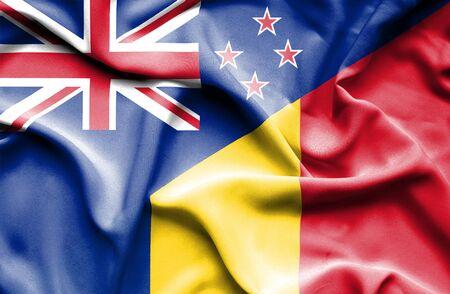 bandera de nueva zelanda: Ondeando la bandera de Rumania y Nueva Zelanda Foto de archivo