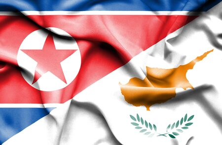 north korea: Waving flag of Cyprus and North Korea Stock Photo