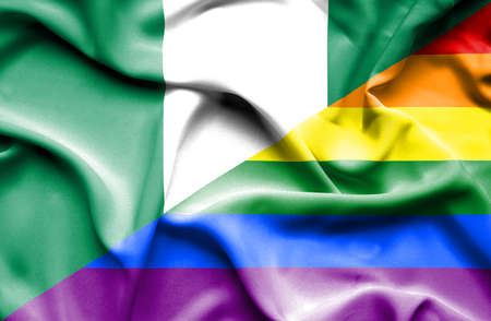 pride: Waving flag of Pride and Nigeria Stock Photo