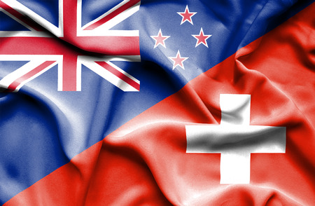 Waving flag of Switzerland and New Zealand