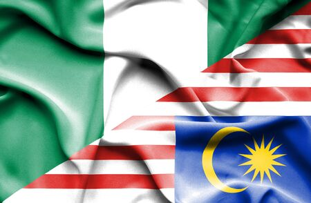 nigeria: Waving flag of Malaysia and Nigeria