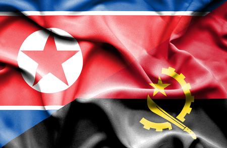 angola: Waving flag of Angola and North Korea