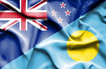 palau: Waving flag of Palau and New Zealand