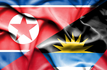 antigua: Waving flag of Antigua and Barbuda and North Korea