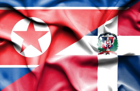 north korea: Waving flag of Dominican Republic and North Korea Stock Photo