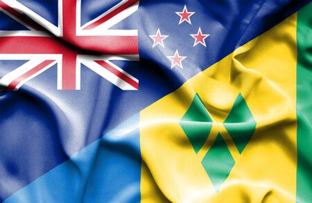 grenadines: Waving flag of Saint Vincent and Grenadines and New Zealand Stock Photo