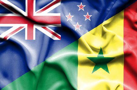 bandera de nueva zelanda: Ondeando la bandera de Senegal y Nueva Zelanda Foto de archivo