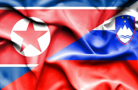 north korea: Waving flag of Slovenia and North Korea
