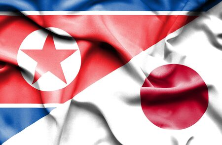 north korea: Waving flag of Japan and North Korea