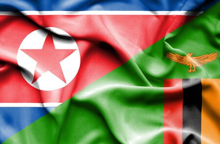 zimbabwe: Waving flag of Zimbabwe and North Korea