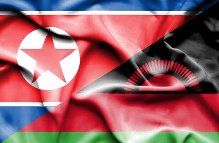 north korea: Waving flag of Malawi and North Korea Stock Photo