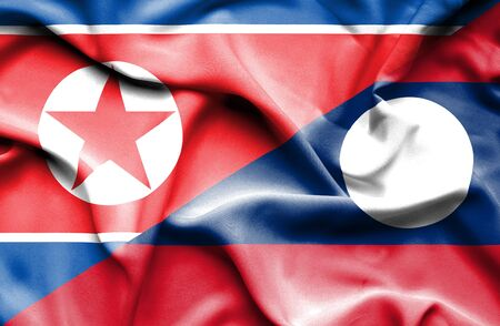 north korea: Waving flag of Laos and North Korea Stock Photo