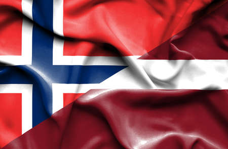 latvia: Waving flag of Latvia and Norway Stock Photo