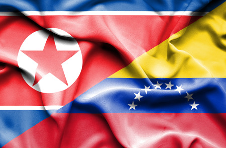 north korea: Waving flag of Venezuela and North Korea Stock Photo