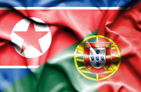 north korea: Waving flag of Portugal and North Korea Stock Photo
