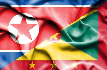 guernsey: Waving flag of Guernsey and North Korea
