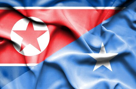 somalia: Waving flag of Somalia and North Korea