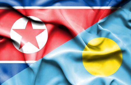 palau: Waving flag of Palau and North Korea