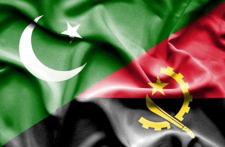 angola: Waving flag of Angola and Pakistan