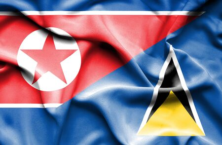 st lucia: Waving flag of St Lucia and North Korea