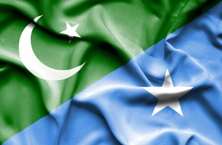 somalian culture: Waving flag of Somalia and Pakistan Stock Photo