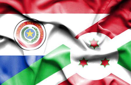 burundi: Waving flag of Burundi and Paraguay Stock Photo