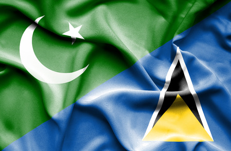 st: Waving flag of St Lucia and Pakistan Stock Photo