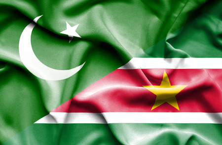 suriname: Waving flag of Suriname and Pakistan Stock Photo