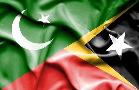 flag of pakistan: Waving flag of East Timor and Pakistan Stock Photo
