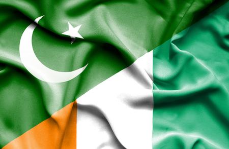 coast: Waving flag of Ivory Coast and Pakistan Stock Photo