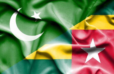 togo: Waving flag of Togo and Pakistan