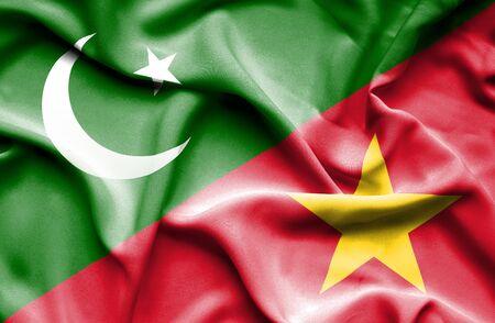 vietnam war: Waving flag of Vietnam and Pakistan Stock Photo