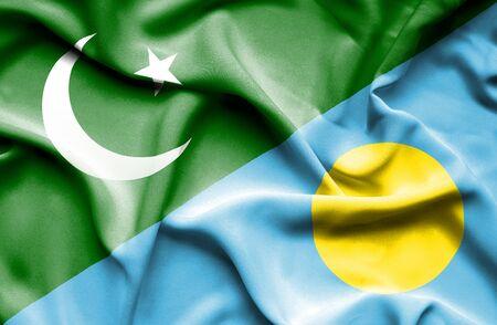 palau: Waving flag of Palau and Pakistan