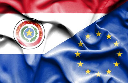 european union: Waving flag of European Union and Paraguay