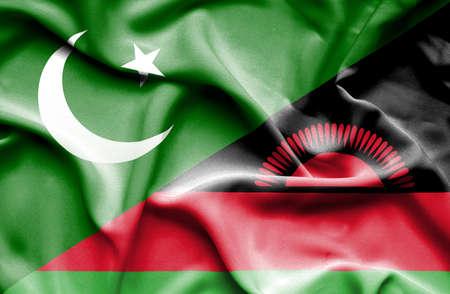 malawi: Waving flag of Malawi and Pakistan