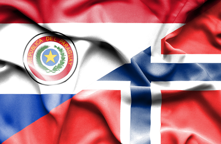 norway flag: Waving flag of Norway and Paraguay Stock Photo