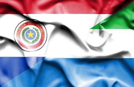 sierra leone: Waving flag of Sierra Leone and Paraguay Stock Photo