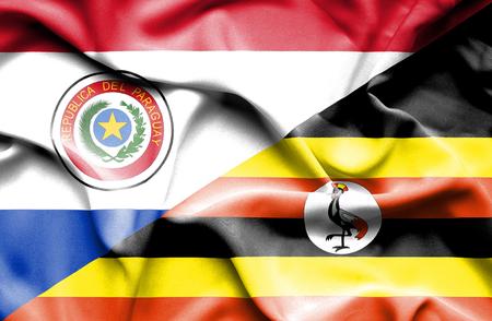 uganda: Waving flag of Uganda and Paraguay