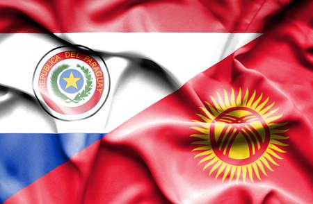 kyrgyzstan: Ondeando la bandera de Kirguistán y Paraguay