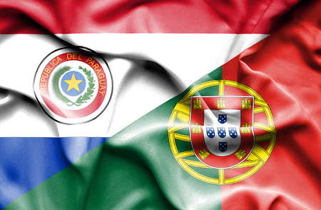 portugese: Waving flag of Portugal and Paraguay Stock Photo