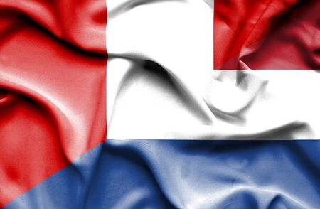 dutch culture: Waving flag of Netherlands and Peru Stock Photo