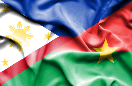 burkina faso: Waving flag of Burkina Faso and Philippines