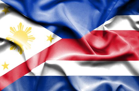 costa rican flag: Waving flag of Costa Rica and Philippines Stock Photo