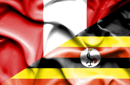 uganda: Waving flag of Uganda and Peru Stock Photo