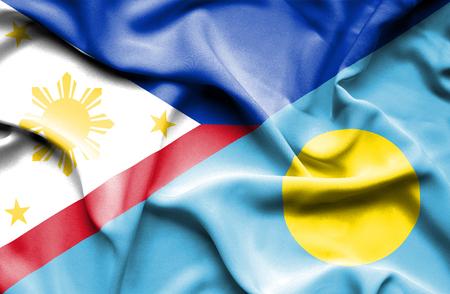 palau: Waving flag of Palau and Philippines