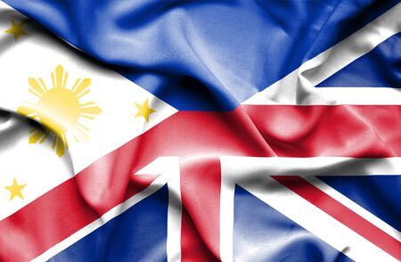 great britain flag: Waving flag of United Kingdon and Philippines Stock Photo