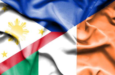 ireland flag: Waving flag of Ireland and Philippines Stock Photo