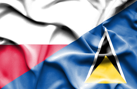 st: Waving flag of St Lucia and Poland Stock Photo